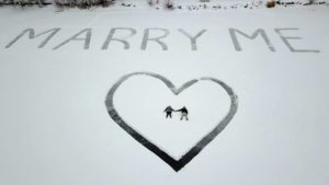 'Marry Me' etched in snow, seen from above
